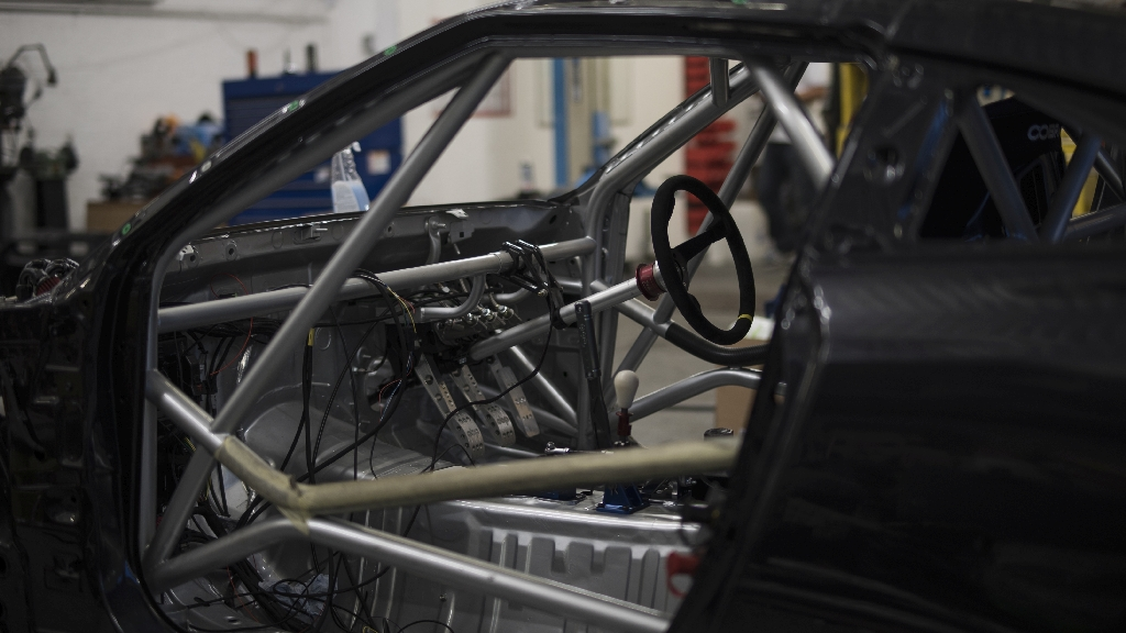 The cage would not only serve its main purpose of safety, but it would also inter grate with many components of the build housing such parts as the Nascar steering column, OBP pedal box and more.